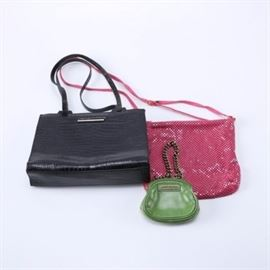 Women's Handbags Including Cole Haan: A grouping of women's handbags. This selection includes three bags, featuring a pink mesh Whiting and Davis, a black, crocodile-embossed leather Cole Haan, and a floral, green leather coin purse by Isabella Fiore. Each item is labeled by the manufacturer.