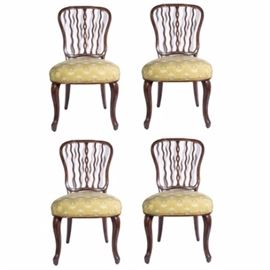"Theodore Alexander ""Seddon"" Chairs: A set of four Theodore Alexander Seddon chairs from the Althorp Living History collection. Each chair is crafted from aged mahogany and has a shaped back with serpentine verticals. The chairs have rounded upholstered seats with nailhead trim over cabriole legs to the front and saber legs to the back."