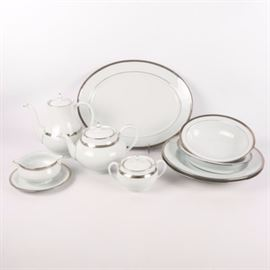 "Haviland ""Symphonie Platine"" Limoges Serving Set: A Haviland Limoges Symphonie Platine serving set. The pattern has an Art Deco style platinum band on a crisp white ground. The set features one oval platter, two round serving bowls, two oval serving bowls, a teapot, coffee pot, sugar bowl and gravy boat. It is marked ""Haviland Limoges, Symphonie Platine"" in blue to the underside."