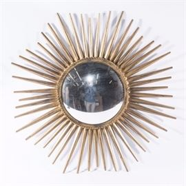 "Starburst Mirror: A gilt tone starburst wall mirror. The piece features a convex mirror with a distressed starburst frame with rope trim accents. The mirror is marked ""Made in India"" to the back and has a hook for hanging."
