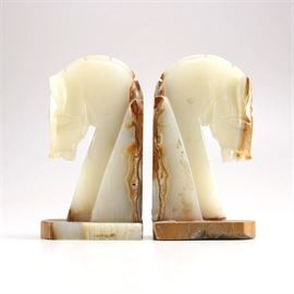 Agate Horse Bookends: A pair of agate horse bookends. The pair is made of a white agate with brown accents and features groomed button braids on elegant profiles. There is no discernible maker's mark.