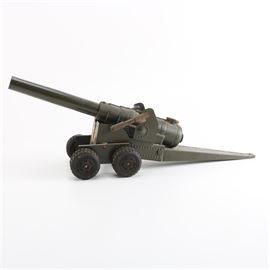 """Miniature Cannon Toy: A miniature cannon. This miniature metal cannon features four sets of double wheels and two openings on the top at back. The cannon is labeled """"Do not look into barrel of cannon when firing""""."""