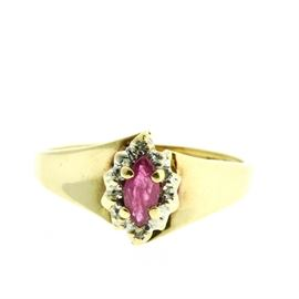 Ruby and Diamond Yellow Gold Cocktail Ring: A 10K yellow gold cocktail ring featuring a marquise cut ruby in a halo accented by diamonds, set above smooth, tapering shoulders just offset from one another.