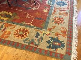 Persian Heriz rug with  brick colored center and ivory and blue border 	9' x 12', 20th c