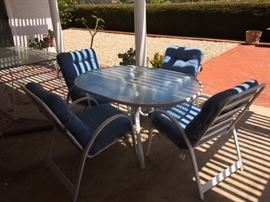 Umbrella Metal Patio Table with Blue Upholstered Cushions