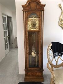 Howard Miller Grandfather Clock. One owner, registered with all paperwork.