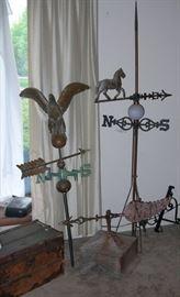 Eagle weathervane, cupula, horse weathervane and lightning rod.