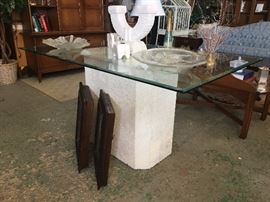 Glass dining table with white pedestal