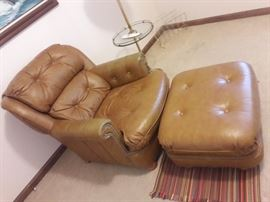 Carmel Brown leather lounge chair & ottoman $160  Leather chair measures 33 wide 22 deep 32 high. Ottoman measures 25x22 12 high. Brass divets. Sits lower to the ground.