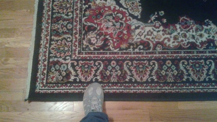 One of 2 area rugs