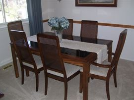 Mid century glass top table, 6 chairs and one leaf.