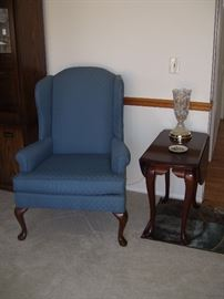 One of 2 wing back chairs with drop leaf end table.