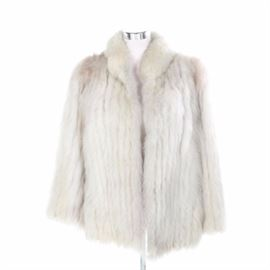 Blue Fox Fur Coat: A blue fox fur coat. The coat has a standing collar with no closure. The coat is a size small and was made in Hong Kong. The interior is monogrammed with a full name.