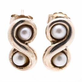 Tiffany & Co. Sterling Silver and Pearl Earrings: A pair of Tiffany & Co. sterling silver and pearl earrings. These drop earrings feature undulating figure eight shapes that have two cultured pearls each set in the negative spaces.