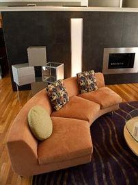 "Minotti Dubuffet round sofa (Each section is 8' long, 36"" deep), Lago Cubes, DWR Cortina floor light."