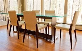 """Glass top dining table, with wood and metal base. Table measures 94.5"""" long, 39.5"""" wide. Six Cattelan Italia leather Arcadia chairs."""