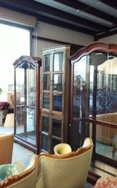 Many curio cabinets and glass shelves.   Side entry cabinets and in great shape