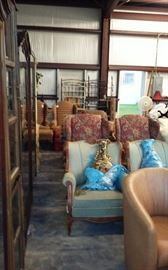 Several matching chairs,   some with matching ottoman.