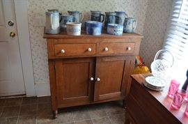 American Primitive Kitchen Cabinet with 2 drawers and double doors.
