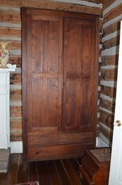 American Primitive Hand Crafted Wardrobe just notice the intricate carving that went into just the locking system