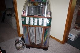 Vintage Rock Ola Rocket Jukebox with extra records.