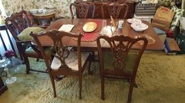 5 Chippindale Style Dinning Chairs.  4 original chairs are matching,  one was added .