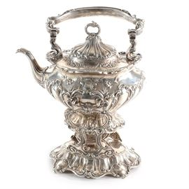 "Sterling Silver Gorham ""Chantilly"" Teapot on a Warming Stand: A sterling silver Gorham Chantilly teapot on a warming stand. This teapot has a Rococo styling with Art Nouveau influence with a swag and foliate design. Gorham maker mark, ""Sterling A601 3 7/8 pint"" to the backside. Total approximate weight is 67.245 ozt."