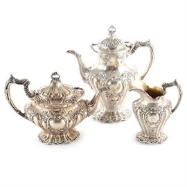 "Gorham Sterling Silver ""Chantilly-Grand"" Tea Grouping: A Gorham sterling silver ""Chantilly-Grand"" patterned tea grouping. This collection has a Rococo styling with an Art Nouveau influence with a swag and foliate design. Includes a teapot, a coffee pot, and a creamer. All pieces have a monogrammed ""D"" to center. Gorham maker mark, ""sterling"" and ""A596, A597 and A 599"" to the underside. Total approximate weight is 63.775 ozt."