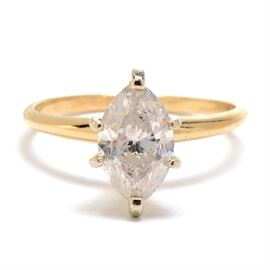 14K Yellow Gold Marquise-Cut 1.43 CTS Diamond Ring: A 14K yellow gold solitaire diamond ring featuring a marquise-cut, 1.43 cts diamond.