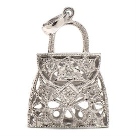 14K White Gold Diamond Figural Handbag Charm Pendant: A 14K white gold figural handbag charm or pendant featuring diamonds. The total diamond carat weight of 0.10 ctw.