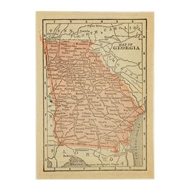Antique Colored Map of Georgia by Blomgren Brothers Engravers: An antique colored map of Georgia by Blomgren Brothers Engravers. This map features the state of Georgia in the U.S. filled with printed pink ink. The verso features printed information about Georgia, Idaho, and other truncated information, indicating that this map is a cut excerpt from a larger printed document. Included is an additional separate piece of paper printed with the title page for Conklin's Hand Manual of Useful Information and World's Atlas published by Laird & Lee Publishers in 1888. Both items are presented together in a protective plastic sleeve.