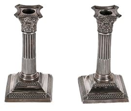1897 Thomas Bradbury & Sons Weighted Sterling Silver Candlesticks: A pair of antique sterling silver candlesticks. This lot includes an 1897 pair by London silversmiths Thomas Bradbury & Sons. They are in the form of corinthian columns, with an acanthus leaf capitals and fluted shafts. The hallmarks for Thomas Bradley and London are located along the bases, and along the undersides are pieces of weighted metal.
