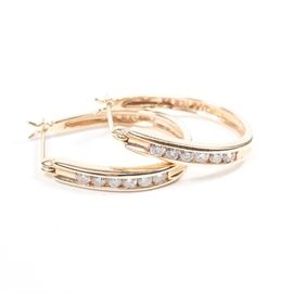 14K Gold and Diamond Hoop Earrings: A pair of 14K yellow gold hoop earrings with channel-set diamonds.