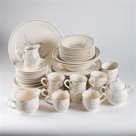 "Noritake Keltcraft Collection: A Noritake Keltcraft collection. Included are ten soup or cereal bowls, eight salad plates, ten dinner plates, ten teacups, ten saucers, a round serving platter, two round serving bowls, and a cream and sugar set. There are fifty-one total pieces in an ivory tone decorated with a muted blue, orange and gray floral and butterfly pattern. The dishes are marked ""Keltcraft designed by Noritake, Ireland, 9109, Kilkee""."