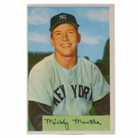 1954 Mickey Mantle New York Yankees Bowman Baseball Card: A 1954 (HOF) Mickey Mantle New York Yankees Bowman baseball card. This card features a close-up image of this legendary switch-hitter. This colorful Bowman card is #65 and depicts a replica signature of this Yankees Hall Of Fame member. The card has a left corner crease. With a clean front and back, the card is off-center and housed in a protective top loader. Mickey Mantle had an illustrious career with the New York Yankees. He is a member of the National Baseball Hall Of Fame in Cooperstown, New York.