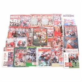"1980s-1990s Ohio State Football Programs: An assortment of 1980s-1990s Ohio State Buckeyes football programs. This selection includes programs titled ""Battle Cry,"" and ""Today's Game."" Many of the Buckeyes Big Ten foes are included such as Michigan, Iowa, Wisconsin, Michigan State, Penn State, Illinois, Indiana, and Purdue. Other opponents include LSU, Oklahoma State, Notre Dame, Syracuse, Boston College, Colorado, and Washington. Each publication is housed in a plastic protective top loader. Please note, EBTH did not inspect each program for the condition and completion."