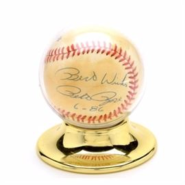 "Pete Rose Signed Baseball: A Pete Rose autographed National League (Feeney President) baseball. Pete signed one of the side panels and added, ""Best Wishes"" and ""6-86"" with a blue ink pen. The ball comes in a baseball holder. His signature has not been authenticated."