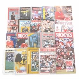 Twenty 1980s-1990s Ohio State Football Programs: An assortment of 1980s-1990s Ohio State Buckeyes football programs. This selection includes programs such as Alabama vs. Ohio State with an illustration of Woody Hayes and Bear Bryant on the front cover. Many of the Buckeyes Big Ten foes are included such as Minnesota, Michigan, Iowa, Wisconsin, Northwestern, Illinois, Indiana, and Purdue. Other opponents include Washington, Oregon, LSU, Colorado, West Virginia, and Syracuse. Each publication is housed in a plastic protective top loader. Please note, EBTH did not inspect each program for the condition and completion.