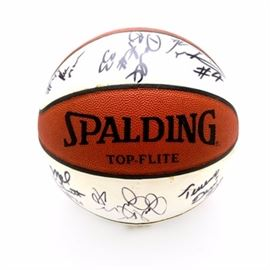 1996-98 Bearcats Signed Basketball: A 1996-98 University of Cincinnati men's autographed basketball. There are fourteen signatures, here are thirteen of the names: Bob Huggins (Head Coach), Melvin Levett, Ruben Patterson, Jackson Julson, Terrence Davis, Bobby Brannen, James Stock, Danny Fortson, Charles Williams, Damon Flint, Kenyon Martin, Darnell Burton and Rodrick Monroe; there is one signature that is illegible. The basketball is a two-tone Spalding Top-Flite. The white panels are smooth, made for signatures. The signatures have not been authenticated.