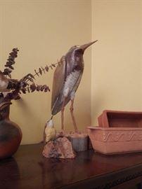 Bird figurine carved from wood by Lance Lichtensteiger.
