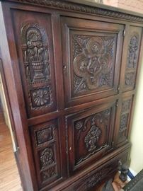 Lovely old antique cabinet with lots of carvings on the front.