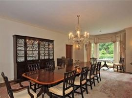 Quadruple pedestal dining table (but only 4 side chairs), oversized china breakfront