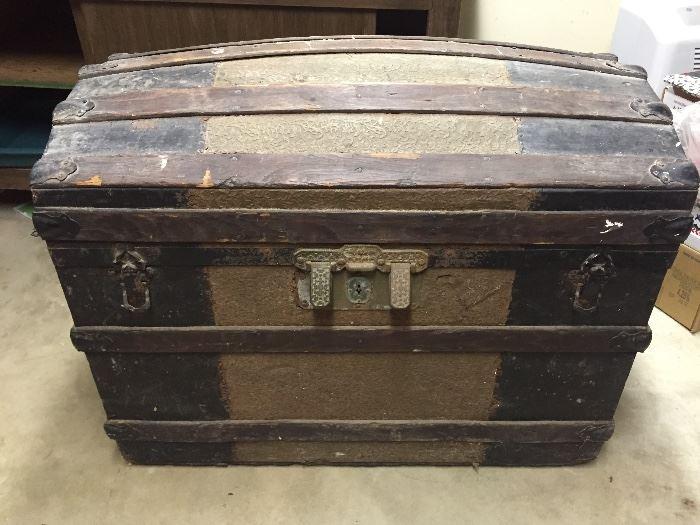 antique humpback metal and wood trunk