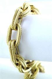 """Lot 2: 18kt yellow gold large linked bracelet, engraved design, signed AR, stamped 750, 8""""L., 40.1 grams"""
