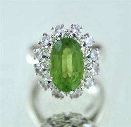 Lot 4: Ballerina style ring in (tested) 14kt white gold set w/approx. 3.84 ct light yellowish green oval tourmaline and approx. 2.0 ct tw round brilliant cut's, 18 mm wide, size 5.5, 6.8 grams