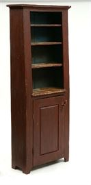 """Lot 10: Small early 19th C. floor cupboard, open canted top with raised panel door below, red paint, 79""""H. x 28""""W."""