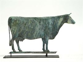 """Lot 12: Late 19th C. cow weathervane with horns, in an old verdigris surface, 24.5""""L. x 15""""H. VT estate"""