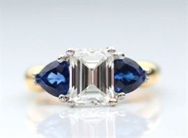 Lot 11: Emerald cut diamond and sapphire ring set in 18kt yellow gold w/platinum settings, center is approx. 1.98 ct, good color, VS clarity, sapphires are dark violetish blue with strong saturation, approx. 1.0 ct tw, size 6, 6.9 grams