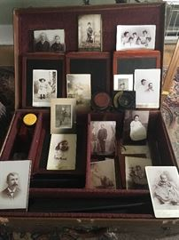 This suitcase isn't just a photo display, although these early prints (some from Cripple Creek Colorado) are terrific- but the entire Comley Camera set up ant tripod fit within.  Amazing piece of history.