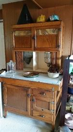 very cool kitchen queen with tambour door and slad glass upper doors.  tin flour sifter, glass dispenser, enamel top.  needs a bit of work but is very good overall